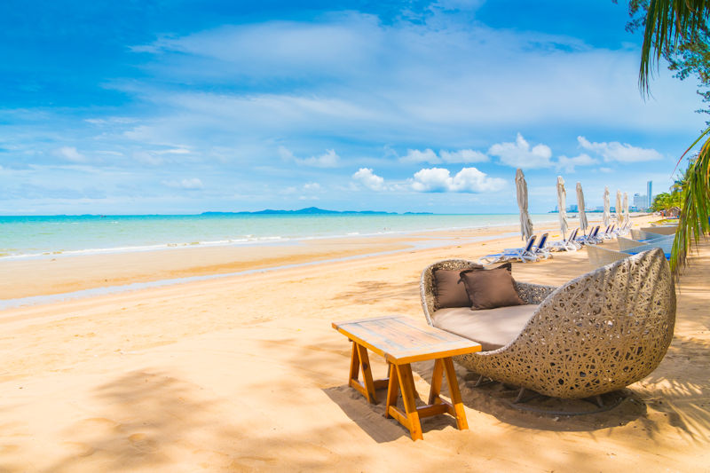 Chair and table dinning on the beach and sea with blue sky background